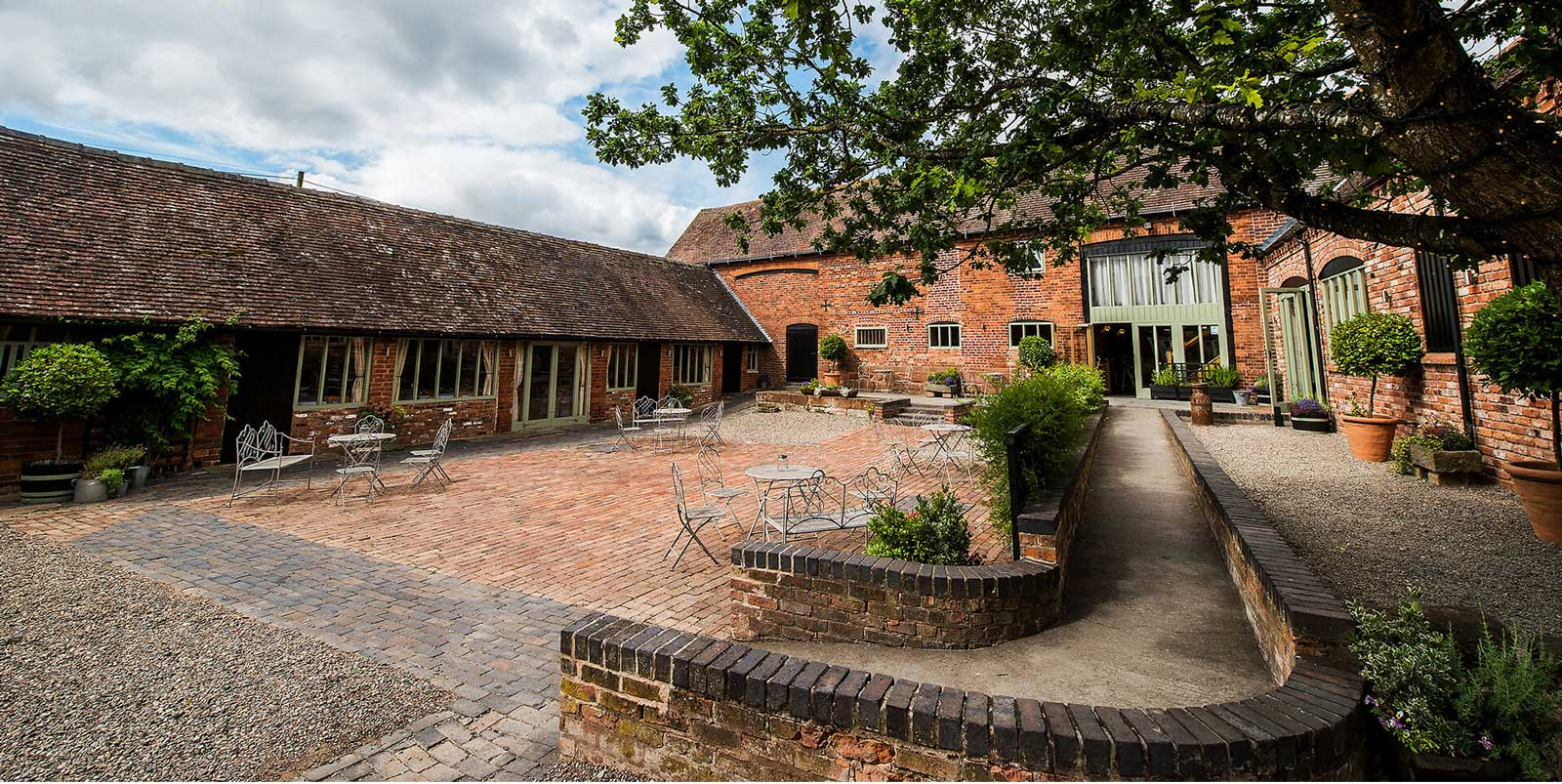 Curradine Barns is the only venue to look at if you're looking to be surrounded with beauty at a barn wedding venue in Worcestershire
