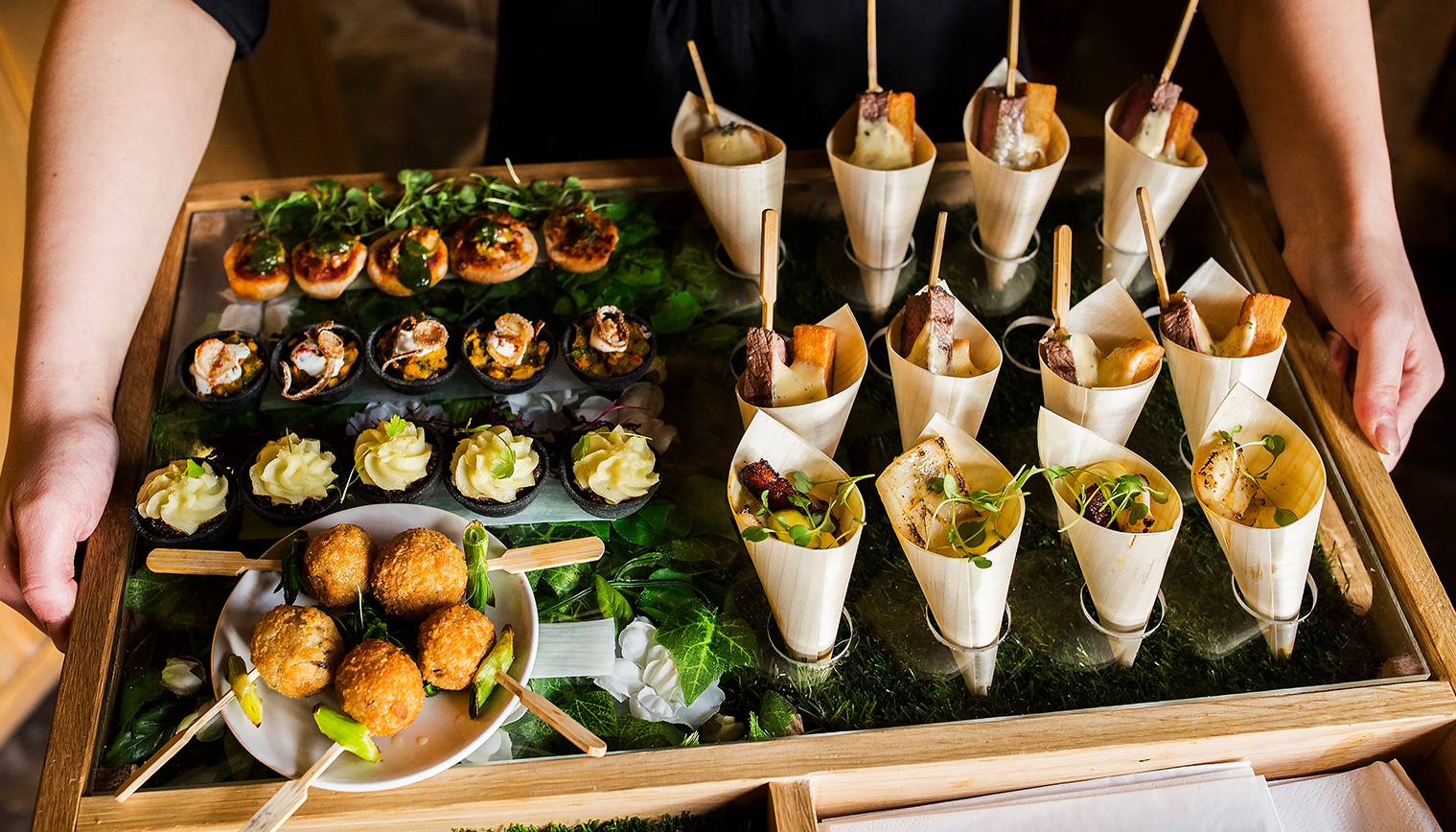 canapes being served to guests during the drinks reception at Curradine Barns