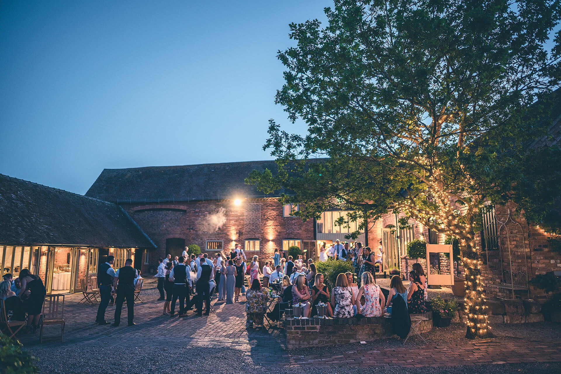 curradine barns guests evening courtyard