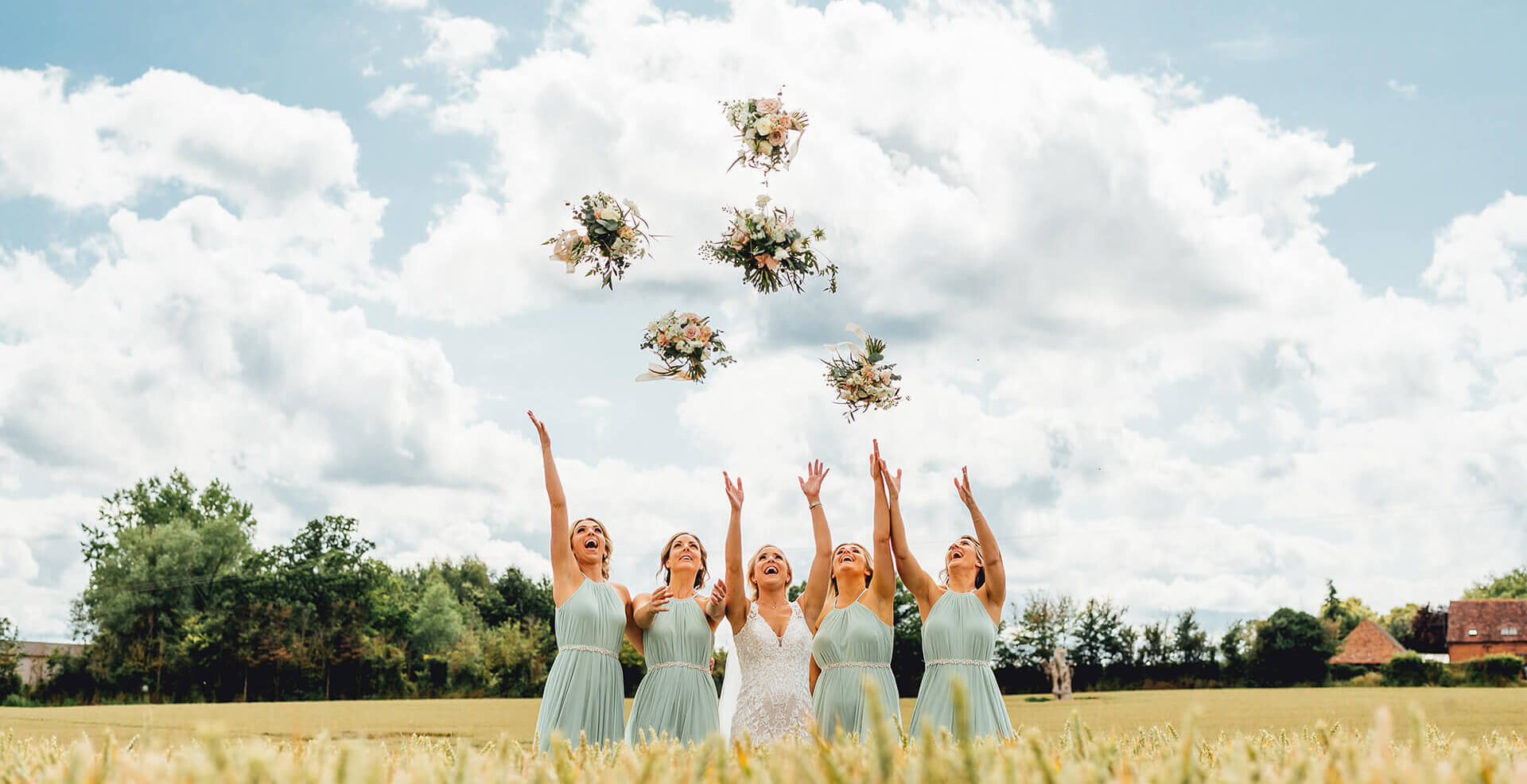 curradine barns bridesmaids throwing bouquets